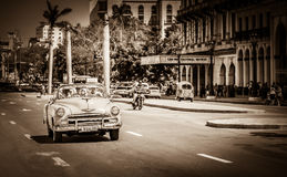 HDR - American Cabriolet vintage car drives with tourists on the main street in Havana Cuba - R Stock Image