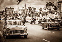 HDR - American classic cars on the main street before the capitolio in Havana Cuba - Retro Seri. E SEPIA Cuba Reportage Royalty Free Stock Photography