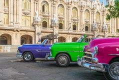 HDR - American colorfully convertible vintage cars parked on the side strip before aGran teatro in Havana Cuba - Serie Cuba Report. Age Royalty Free Stock Photo