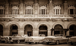 HDR - American convertible vintage cars parked lined up on the side street in Havana Cuba - Ret. Ro Serie SEPIA Cuba Reportage Stock Photography