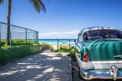 HDR - American green classic car on the beach in Varadero Cuba - Serie Cuba Reportage.  royalty free stock photo