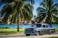 HDR American yellow classic cabriolet in Cuba as taxi Royalty Free Stock Photography