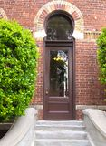 HDR arched doorway in a brick wall Stock Photo