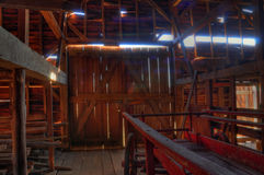 HDR barn. Interior of barn with wagon and hay Royalty Free Stock Photography