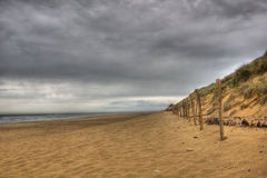 HDR beach scene. Dramatic wild beach scene, on the Western French Coast Royalty Free Stock Images