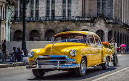HDR - Beautiful american yellow vintage car drived in Havana Cuba - Serie Cuba Reportage.  stock photography