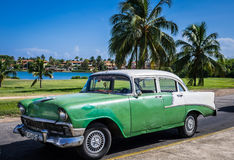 HDR beautiful green classic car with white roof in VIlla Clara Cuba Royalty Free Stock Photos