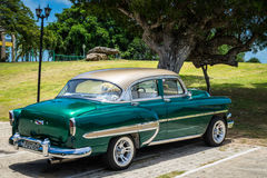 HDR beautiful green vintage car before a hotel in Havanai Cuba Royalty Free Stock Photography
