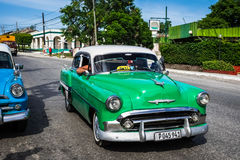 HDR beautiful green vintage car on the street in Cuba Royalty Free Stock Photos