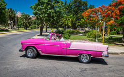 HDR beautiful pink cabriolet Caddillac on the street in Cuba Stock Photography