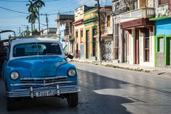 HDR blue american classic car parked on the street in Santa Clara Cuba Stock Image