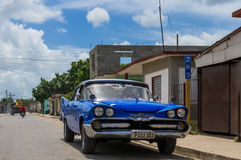 HDR Blue vintage car parked in the countryside from Cuba Stock Photos