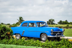 HDR Blue vintage car parked on the parking lot in Havana Cuba Stock Photo
