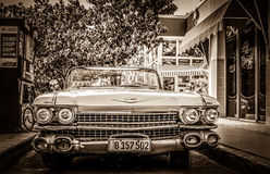 HDR - Cadillac Cabriolet classic car refuel at the gas station - Retro SEPIA Serie Cuba Reportage Royalty Free Stock Photo