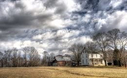 HDR Farmhouse on cloudy day. HDR capture of Farmhouse in country with storm clouds approaching Stock Photography