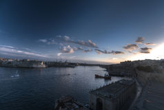 HDR colorful vivid sunset photo over historic Valletta city cityscape Stock Photos