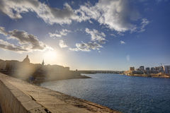 HDR colorful vivid sunset photo over historic Valletta city cityscape Royalty Free Stock Photos