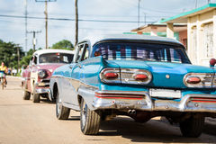 HDR Cuba american blue vintage car parked on the road Stock Images