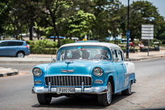 HDR Cuba blue american Oldtimer drives on the Malecon Promenade in Havana Royalty Free Stock Image