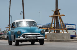 HDR Cuba blue green american Oldtimer drives on the Malecon Promenade in Havana Stock Photo