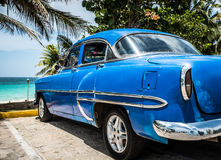 HDR Cuba blue Oldtimer parked near the beach Stock Images