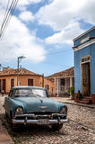 HDR Cuba caribbean blue classic car parked on the street in Trinidad Royalty Free Stock Images