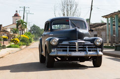 HDR Cuba countryside american black Oldtimer drives on the road Royalty Free Stock Photos