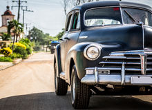 HDR Cuba countryside black Oldtimer drives on the road Stock Photo