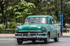 HDR Cuba green american classic car drives on the Malecon Promenade in Havana Stock Photos