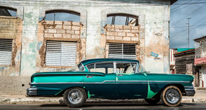 HDR Cuba green american classic car  parked for a building Stock Image