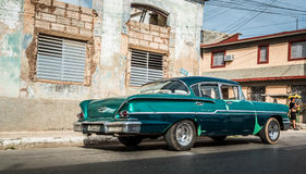HDR Cuba green american classic car  parked for a building Stock Photography