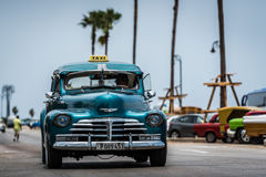 HDR Cuba green american Oldtimer drives on the Malecon Promenade in Havana Royalty Free Stock Photo