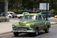 HDR Cuba green american Oldtimer drives on the promenade Malecon in Havana Stock Photos