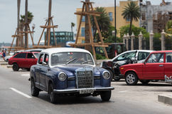 HDR Cuba green blue american Oldtimer drives on the Malecon Promenade in Havana Stock Photography