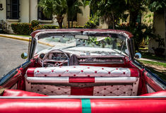HDR Cuba interior view from a red american classic car Royalty Free Stock Image
