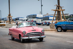 HDR Cuba pink american classic car drives on the Malecon in Havana Stock Images
