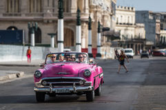 HDR Cuba pink american classic car drives on the street in Havana Royalty Free Stock Photo