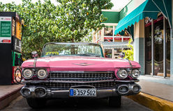 HDR Cuba pink american classic car on a gas station Royalty Free Stock Image