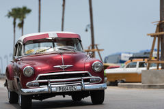 HDR Cuba red american Oldtimer drives on the Malecon Promenade in Havana Stock Photos
