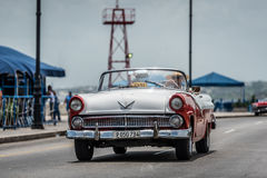 HDR Cuba red white american Oldtimer drives on the Malecon in Havana Royalty Free Stock Photography