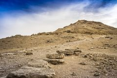 Desert ground and stones with dramatic skies and no people Stock Image