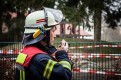 HDR - Firefighter operate with a walkie talkie in action - Serie Firefighter Stock Images