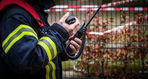 HDR - Firefighter operate with a walkie talkie in action - Serie Firefighter Stock Image