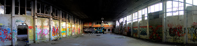 HDR Graffiti. Abandoned factory building with lots of graffiti. High color intensity due to a pseudo HDR imaging technique Stock Photos