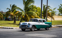 HDR green american classic car with white roof on the street in Cuba Royalty Free Stock Images