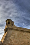 HDR image of Historic tower of the Valletta defense fortifications and Valletta citadel (fortress) Royalty Free Stock Photo