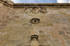 HDR image of Historic Valletta citadel (fortress) structures and one of the popular entrances with an eye above it.  Stock Photo