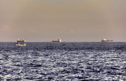 HDR image of 3 large ships on the sea on the horizon Royalty Free Stock Image