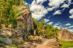 The HDR image of rocks with blue sky. Stock Image