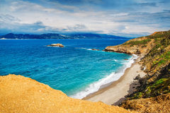 HDR image of a secluded beach on Skiathos island on a cloudy day Stock Images